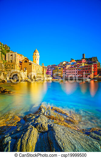 Vernazza village, church, rocks and sea harbor on sunset, Seascape in Five lands, Cinque Terre National Park, Liguria Italy Europe. Long Exposure. - csp19999500