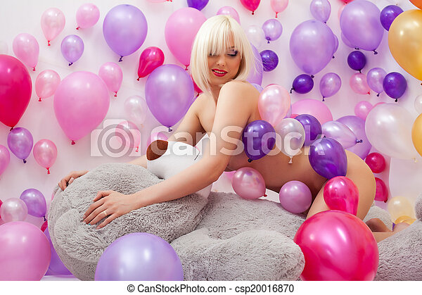 Hot blonde smiling hugging big teddy bear