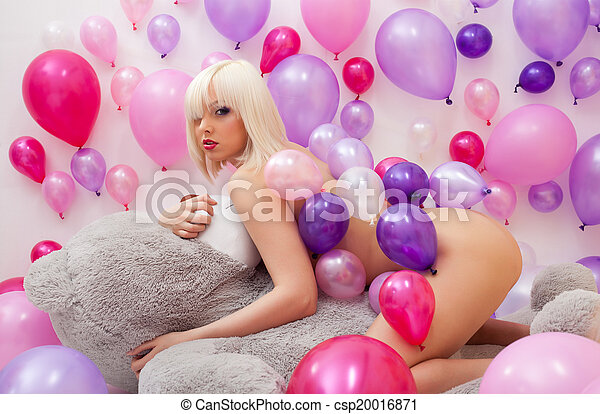 Flirty nude blonde lying on big teddy bear