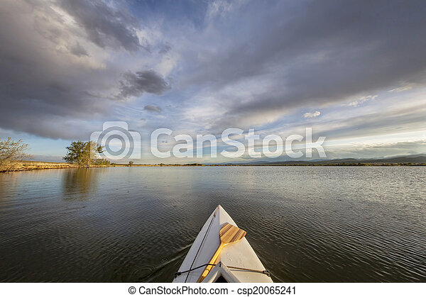 canoe with a paddle on lake - csp20065241