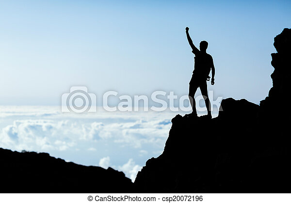 Hiking success silhouette, man trail runner in mountains - csp20072196