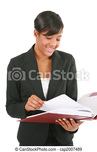 Young African American Businesswoman Reading Reports - csp2007489