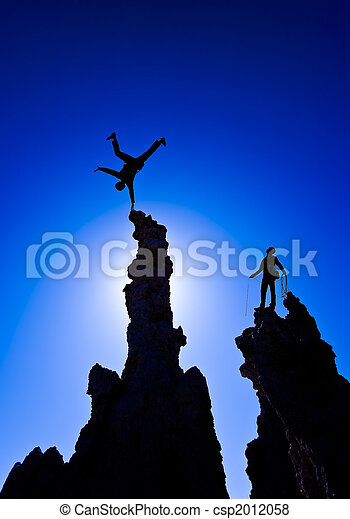 Rock climber on the summit. - csp2012058