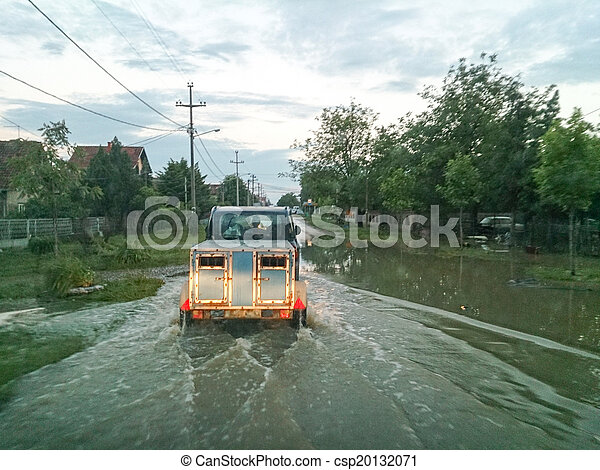 transport animals to safety through a flooded road with car, eva