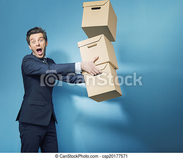 Surprised smart banker with the boxes