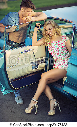 Graceful blond woman sitting in the car - csp20178133