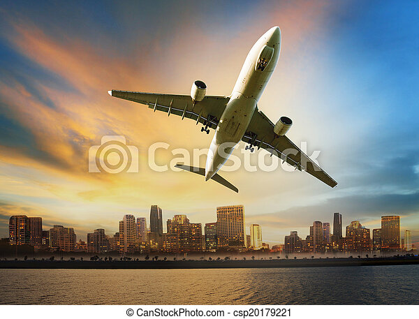 passenger plane flying above urban scene use for convenience air transport and logistic cargo by air transportation - csp20179221