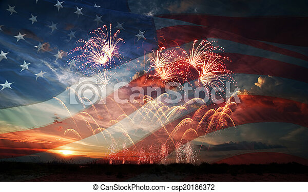 Celebratory fireworks on the background of the US flag and sunrise. Independence day