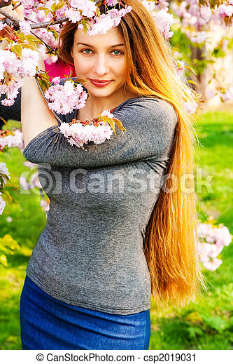 Beautiful serene woman and flower blossoms - csp2019031