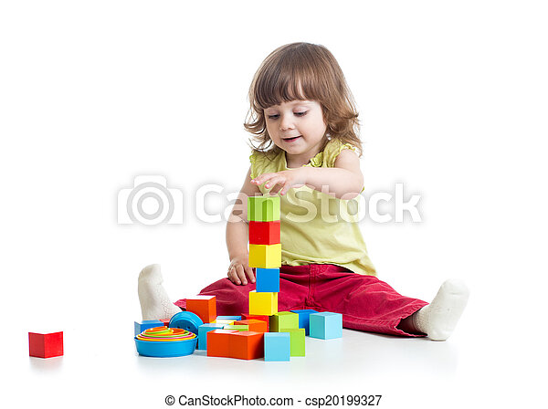 smiling kid girl playing building block toys - csp20199327