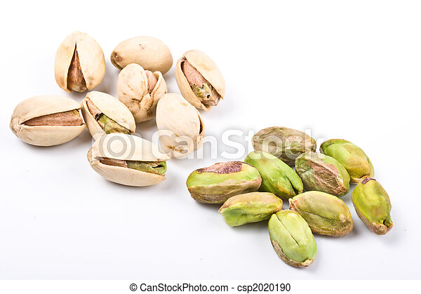Several pistachio nuts naked and in shell close up isolated - csp2020190
