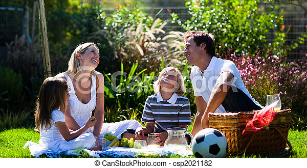 Happy family enjoying the sun in a picnic