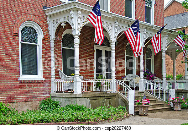 old mansion with American flags - csp20227480
