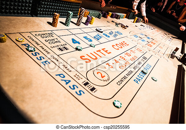 Craps Table and People Gambling all Around - csp20255595