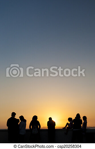 People Contemplating Sunset and Enjoying it in Los Angeles, California. Vertical Image Composition - csp20258304