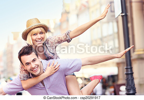 Young crazy couple having fun in the city - csp20291917