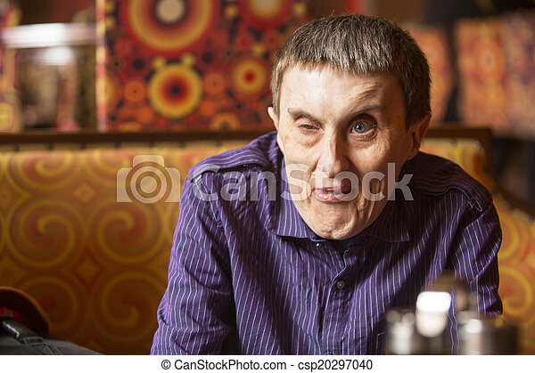 Portrait of disabled man with cerebral palsy in rehabilitation center. - csp20297040