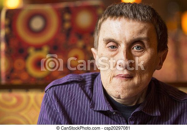 Portrait of disabled man with cerebral palsy in rehabilitation center. - csp20297081