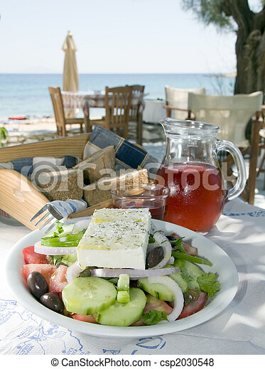 carafe of home made house rose wine and greek salad with feta cheese at greek island taverna with crusty local bread photographed in the greek islands - csp2030548