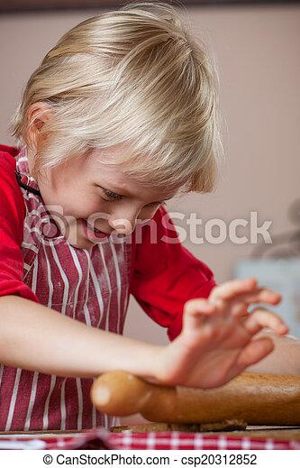 Cute young boy baking - csp20312852