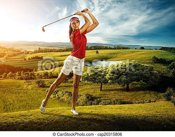 Woman golfer hitting the ball on the background scenery  beautiful - csp20315806