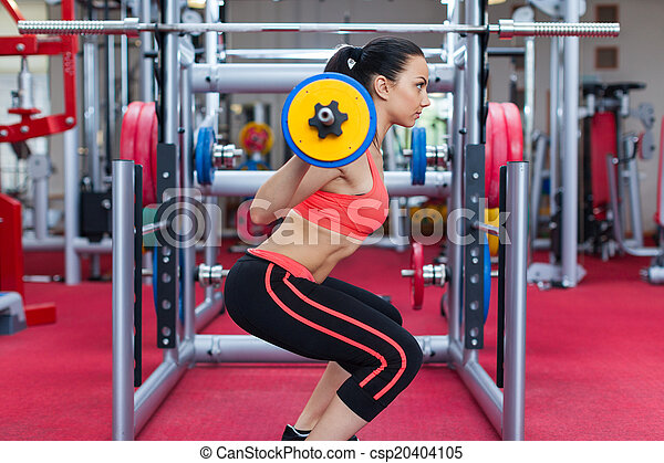 Sport woman exercising gym, fitness center - csp20404105
