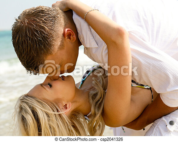 Playful couple making love on the beach - csp2041326