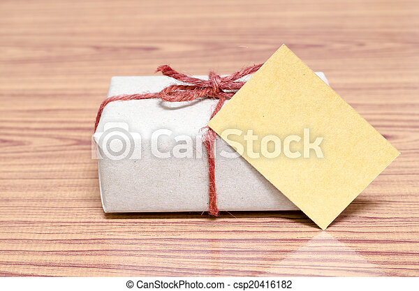 brown gift box and card on wood background