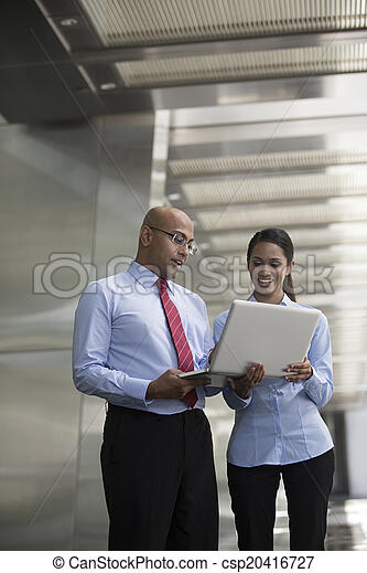 Indian business people looking at a laptop