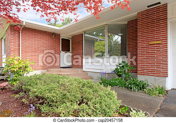 Brick house with entrance porch view