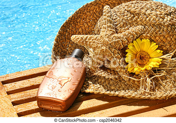 Summer straw hat with tanning lotion - csp2046342