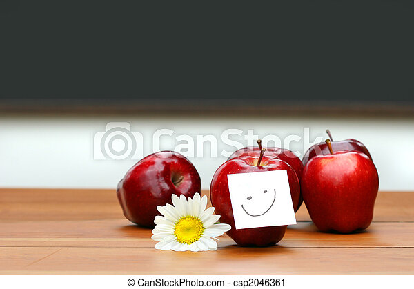 Delicious red apples on desk with blackboard  - csp2046361