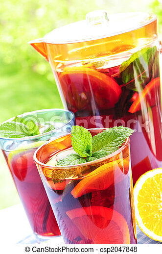Fruit punch in pitcher and glasses - csp2047848
