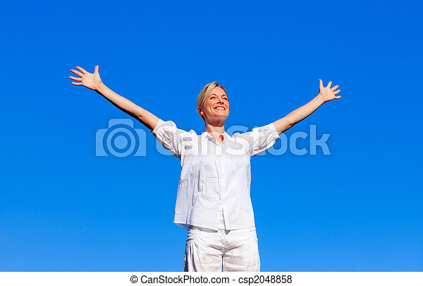 Happy woman feeling free with open arms - csp2048858