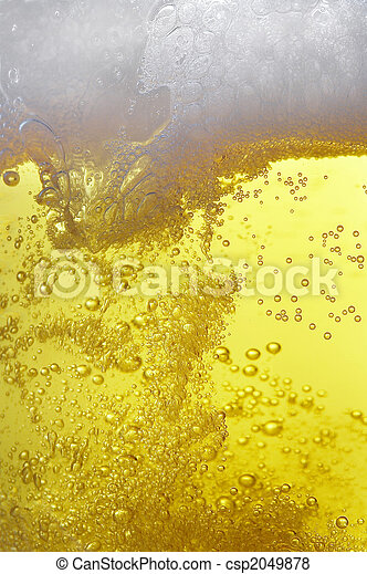 lots of bubbles floating in a beer with froth on top - csp2049878