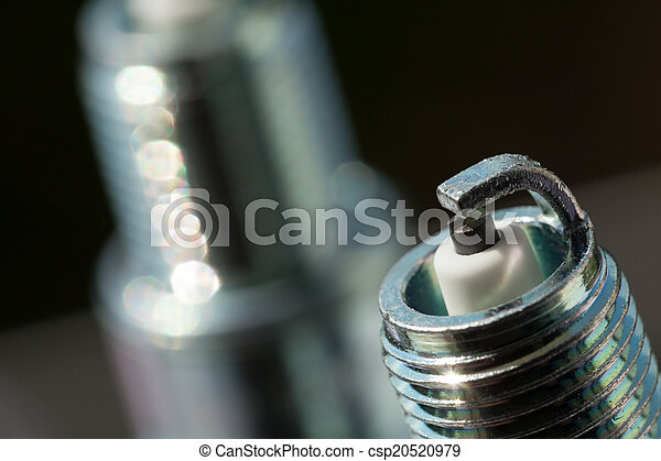 Auto service. Two new spark plugs as spare part of car. - csp20520979