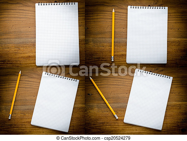Black notebook with pencile on a wood background close up