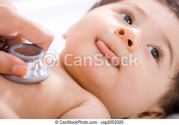 Baby checked by doctor - csp2053325