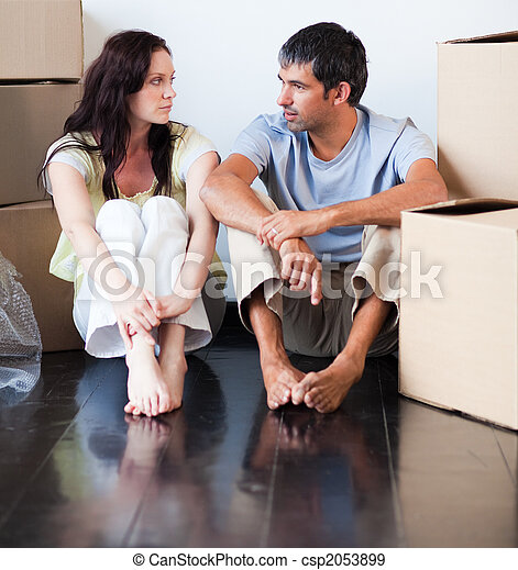 Couple talking about thir new house - csp2053899