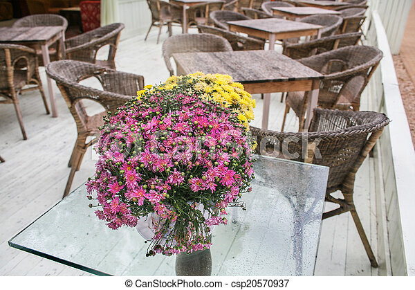 cafe open-air with bouquet in the foreground