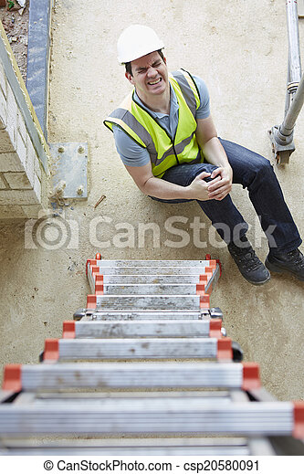 Construction Worker Falling Off Ladder And Injuring Leg - csp20580091