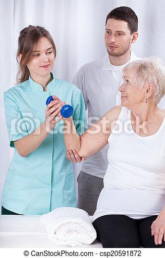 Elderly woman practicing during rehabilitation - csp20591872