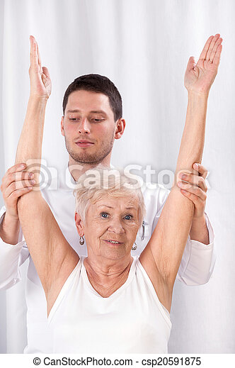 Physiotherapist and elderly woman during rehabilitation - csp20591875