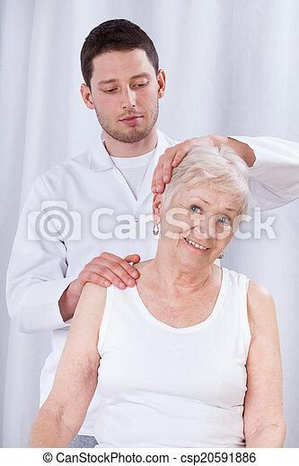 Physiotherapist rehabilitating woman - csp20591886