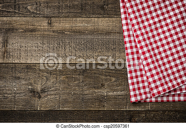 Rustic wooden boards with a red checkered tablecloth - csp20597361
