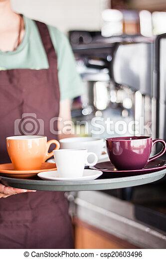 Barista serving set of freshly brewed coffee
