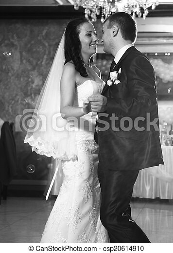Photo of happy newly married couple dancing at restaurant
