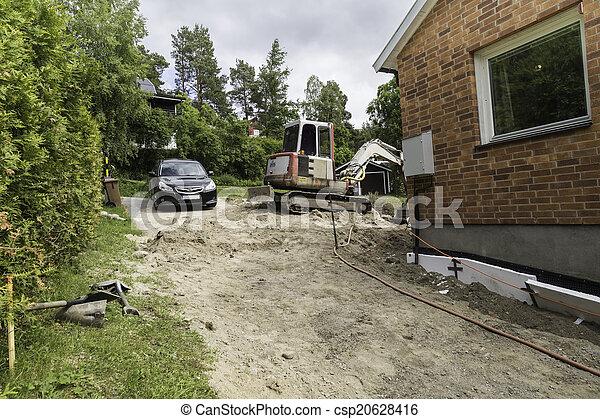 Excavator an a car