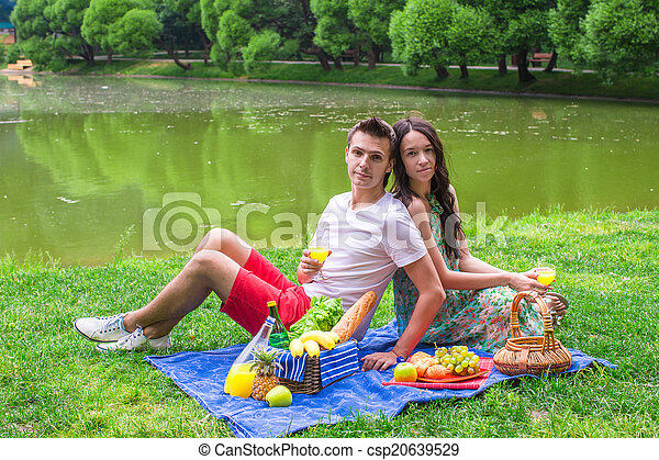Young couple in love on a picnic outdoors - csp20639529
