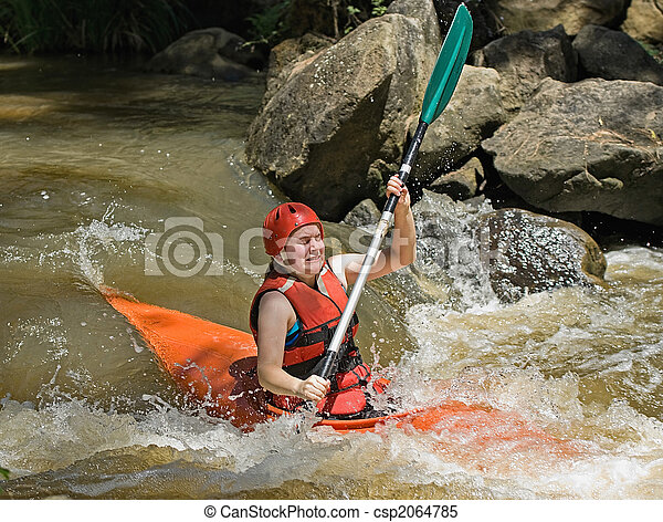 great image of a teenage facing the ordeals and challenge of white water kayaking